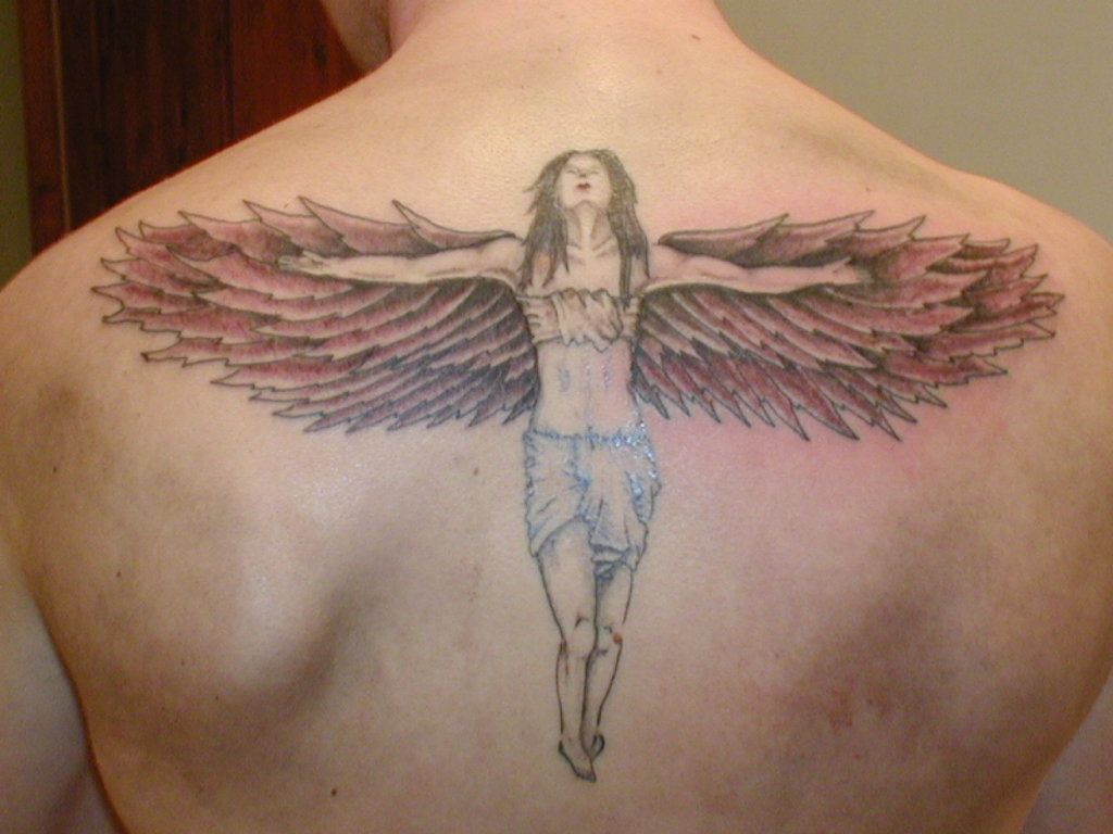 most beautiful angel tattoo designs for 2011. Black Bedroom Furniture Sets. Home Design Ideas