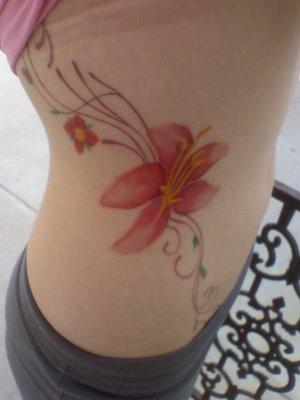 elegant flower rib tattoo for college girls. Black Bedroom Furniture Sets. Home Design Ideas