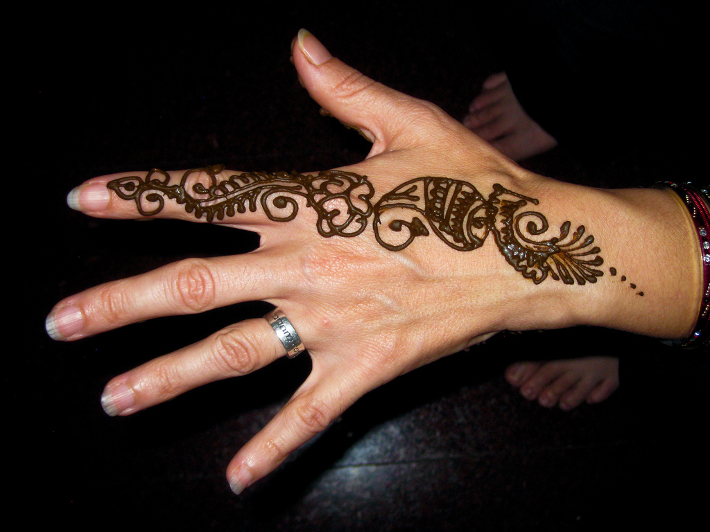 women new year party mehndi images