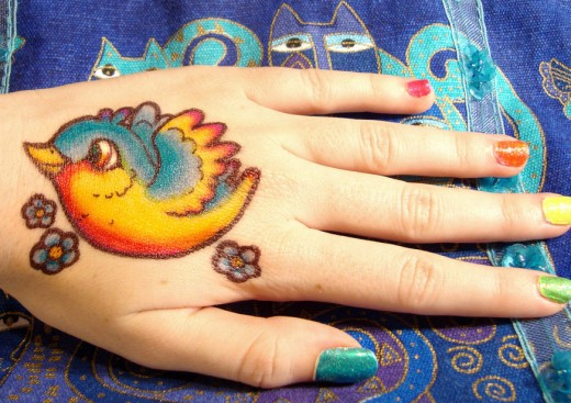 Rainbow Bird Sharpie Tattoo on Hand for Summer