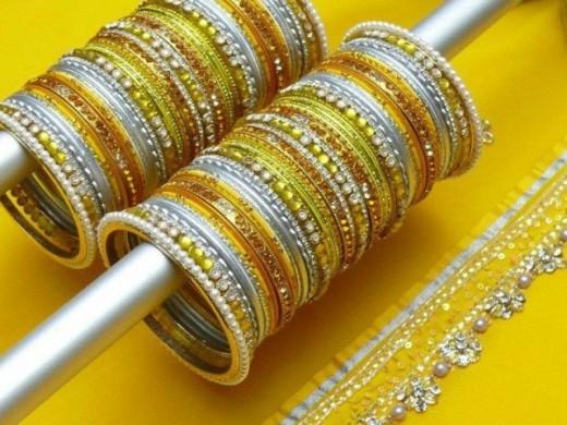 Eid Ul Azha Yellow Bangles Designs For Girls 2015