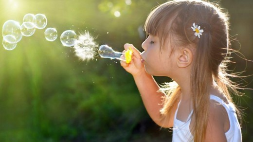 Girl Blowing Bubbles 4K Wallpaper